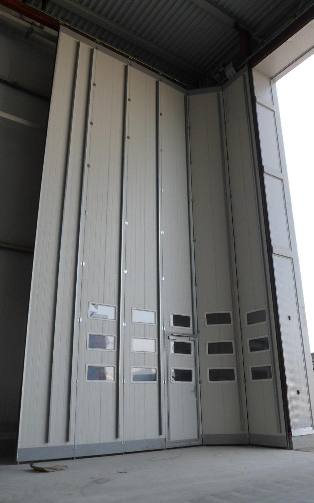 Поворотно-подвесные секционные ворота Ryterna.